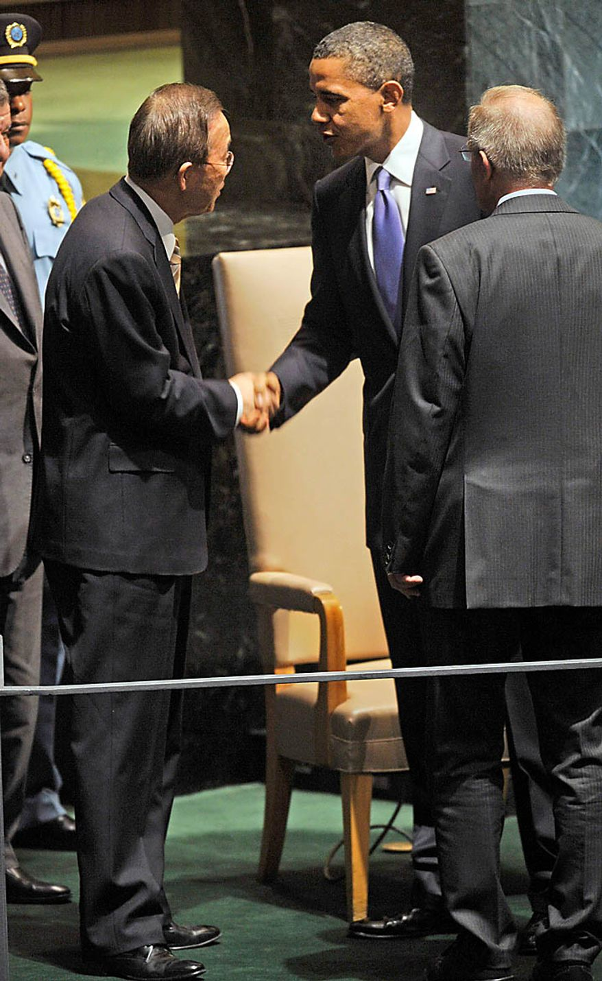 U.S. President Barack Obama, center, shakes hands with United Nations Secretary-General Ban Ki-moon after addressing the United Nations General Assembly at United Nations headquarters on Thursday, Sept. 23, 2010. Looking on at right is General Assembly President Joseph Deiss. (AP Photo/Henny Ray Abrams)