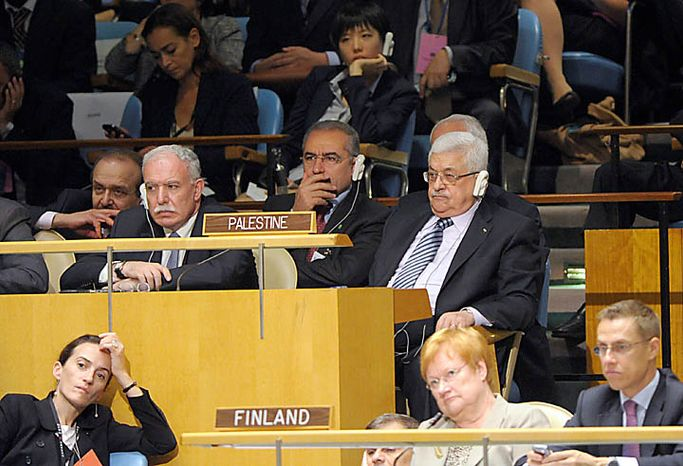 Palestinian President Mahmoud Abbas , right, listens to President Barack Obama address to the United Nations General Assembly at the United Nations, Thursday, Sept.  23, 2010. (AP Photo/Susan Walsh)