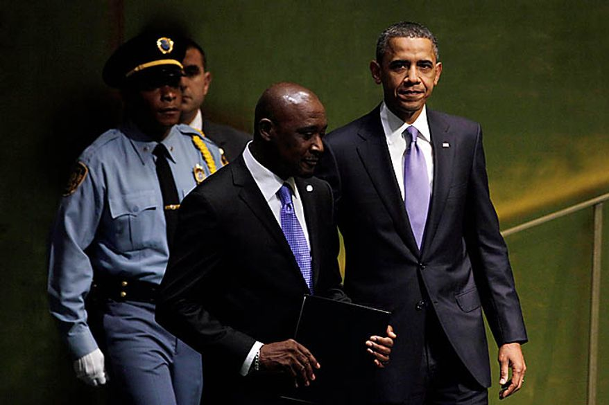 U.S. President Barack Obama, right, is escorted to his address during the 65th session of the United Nations General Assembly on Thursday, Sept. 23, 2010 at the United Nations headquarters. (AP Photo/Richard Drew)