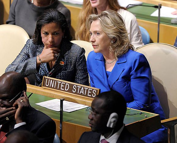 Secretary of State Hillary Rodham Clinton, right, and US Ambassador to the UN Susan Rice wait for President Barack Obama to address the United Nations General Assembly at the United Nations, Thursday, Sept.  23, 2010. (AP Photo/Susan Walsh)