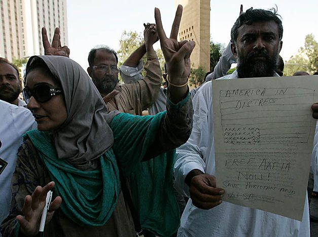 Dr. Fauzia Siddidui, the sister of Aafia Siddiqui, gestures during a protest in Karachi, Pakistan, condemning the sentencing of her sister on Thursday, Sept. 23, 2010. (AP Ph