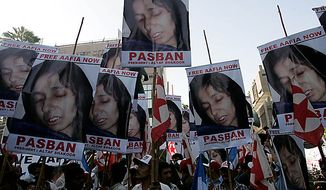 Pakistani protesters rally in Karachi, Pakistan, to condemn the sentencing of Aafia Siddiqui on Thursday, Sept. 23, 2010. (AP Photo/Shakil Adil)