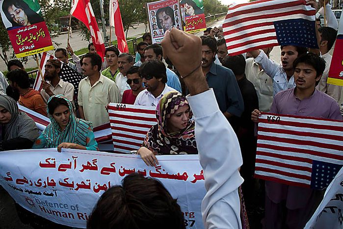 Pakistanis protest on Thursday, Sept. 23, 2010, in Islamabad, Pakistan, to condemn the sentencing of Aafia Siddiqui by a federal judge in New York. Siddiqui, a U.S.-trained Pakistani scientist, was convicted of trying to kill U.S. agents and military officers. (AP Photo/B.K. Bangash)