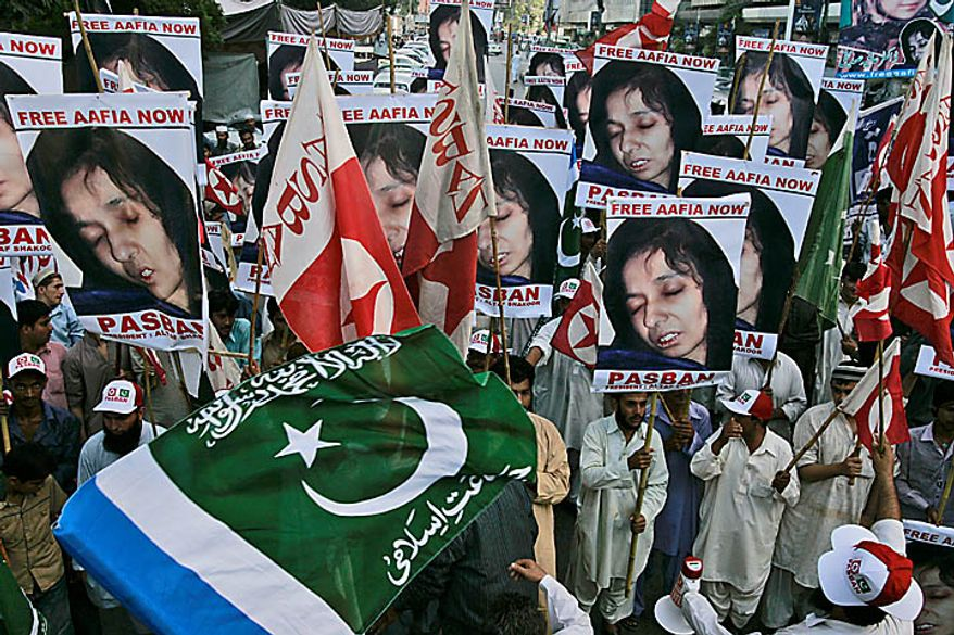 Pakistani protesters rally near the U.S. Consulate in Karachi, Pakistan, on Thursday, Sept. 23, 2010, to condemn the sentencing in New York of Aafia Siddiqui. A U.S. federal judge gave Siddiqui 86 years in prison after a jury found her guilty in February of trying to kill U.S. agents and military officers in Afghanistan in 2008. (AP Photo/Shakil Adil)