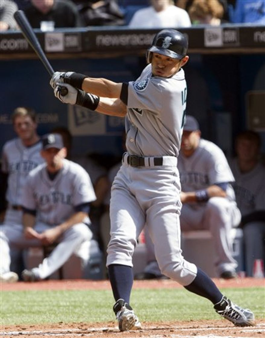 Toronto Blue Jays' Jayson Nix scores on a double by Edwin Encarnacion in the eighth inning of a major league baseball game against the Seattle Mariners, Wednesday, April 13, 2011, in Seattle. The Blue Jays won 8-3. (AP Photo/Elaine Thompson)
