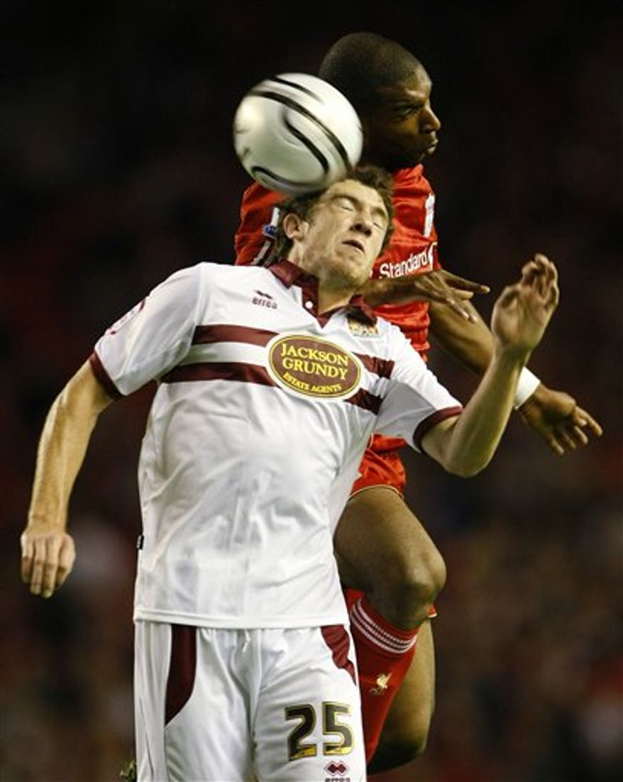 Liverpool manager Roy Hodgson, right, and Northampton Town manager Ian Sampson react during their English League Cup soccer match, Anfield, Liverpool, England, Wednesday Sept. 22, 2010. (AP Photo/Tim Hales)