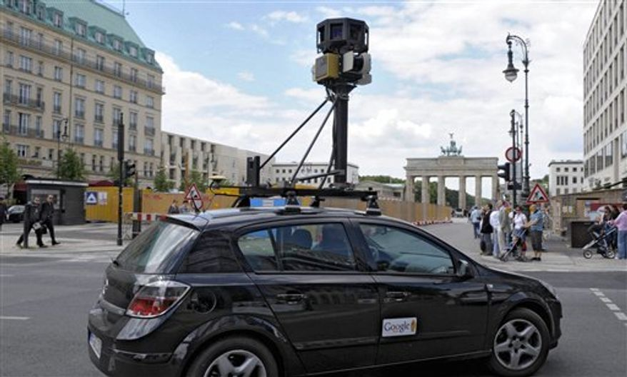 """FILE - In this July 9, 2008 file photo a google street view car drives near the Brandenburg Gate in Berlin, Germany. The Czech Republic's privacy watchdog said Wednesday  Sept 22 2010 that Google has not been granted permission to expand its mapping feature """"Street View"""" in their country because it invades peoples' privacy.  The Office for Personal Data Protection last week refused Google Inc. the necessary registration for """"Street View"""" in the eastern European country following an investigation that began in April but did not explain why.(AP Photo/dda, Michael Kappeler, file)"""