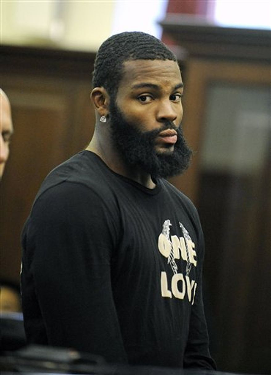 An unidentified court officer gestures to New York Jets wide receiver Braylon Edwards, right, as Edwards appears in court for arraignment on charges of Driving Wile Intoxicated, Tuesday, Sept. 21, 2010 in New York. Police pulled Edwards' Land Rover on Manhattan's west side around 5:15 a.m., because the windows on his vehicle were too tinted, police said. Officers on the scene noticed a strong smell of alcohol and administered a breath test. Edwards was arrested after failing the test and a second test given to him at the police station. (AP Photo/Steven Hirsch, Pool)