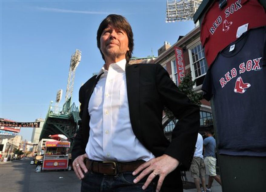 """Filmmaker Ken Burns stands outside Fenway Park in Boston, Wednesday, Sept. 22, 2010. Burns is taking his """"Baseball"""" documentary into extra innings. Burns and co-producer Lynn Novick have created a four-hour update for the 1994 epic that chronicles all that's gone on in the sport since then. """"The Tenth Inning"""" was scheduled to premiere at a Boston theater on Wednesday night, and to show on PBS next week. (AP Photo/Josh Reynolds)"""