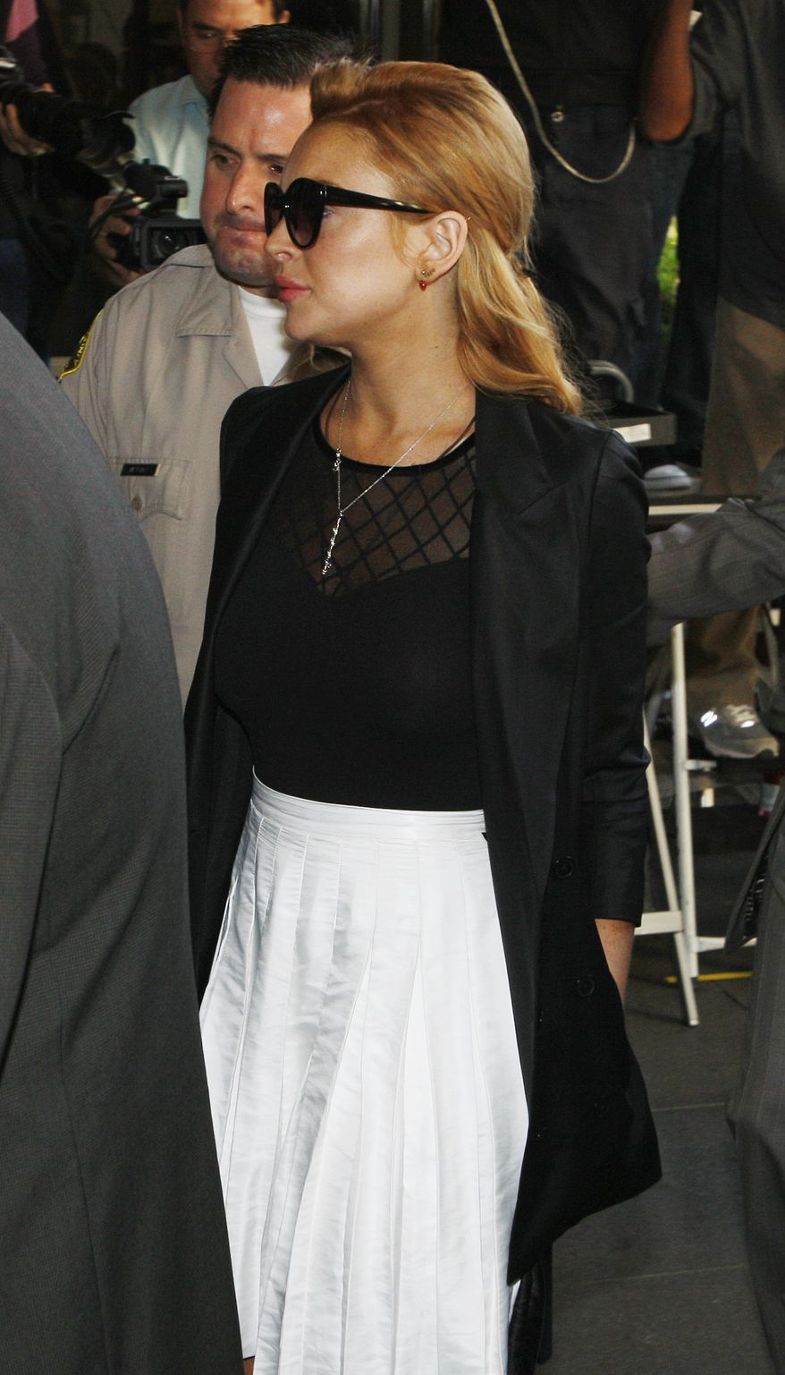 Lindsay Lohan arrives for a hearing Friday at the Beverly Hills Courthouse in Beverly Hills, Calif. (Associated Press)