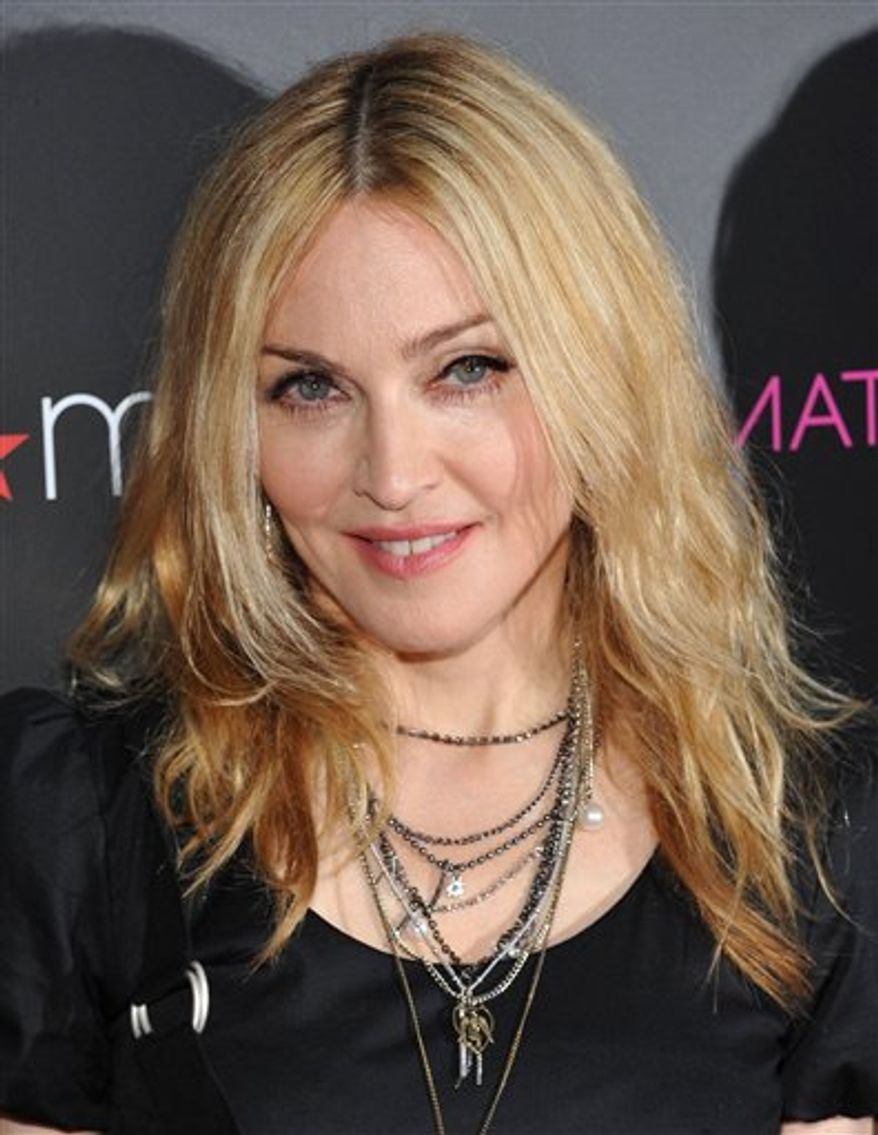 Singer Madonna attends the Material Girl clothing line launch at Macy's Herald Square on Wednesday, Sept. 22, 2010 in New York. (AP Photo/Evan Agostini)