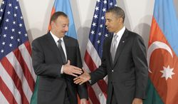 ** FILE ** In this Sept. 24, 2010, file photo, President Obama greets Azerbaijan President Ilham Aliyev during their bilateral meeting in New York. (Associated Press)