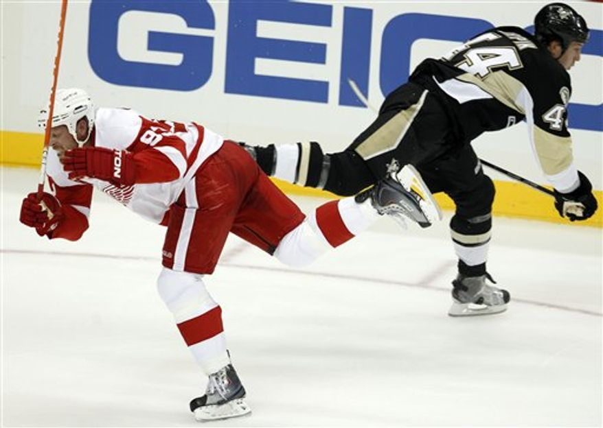 Detroit Red Wings' Johan Franzen, left, collides with Pittsburgh Penguins defenseman Brooks Orpik in the first period of a preseason NHL hockey game in Pittsburgh Wednesday, Sept. 22, 2010. Franzen was helped off the ice after the collision. (AP Photo/Gene J. Puskar)