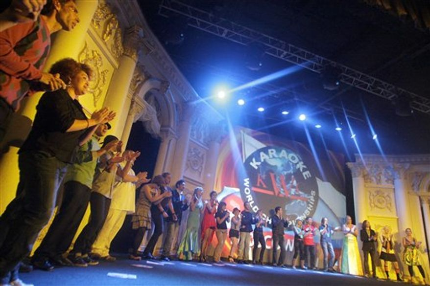 "Participants in the Karaoke World Championships open the show with a group rendition of ""We Are The World"" in Moscow, Russia, Thursday, Sept. 23, 2010. (AP Photo/Mikhail Metzel)"