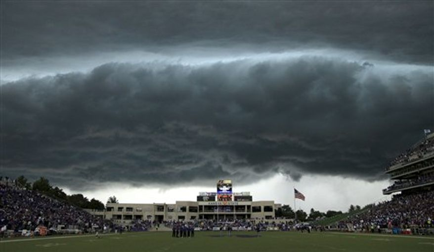 A thunderstorm approaches Bill Snyder Family Stadium during the first quarter of an NCAA college football game between Central Florida and Kansas State Saturday, Sept. 25, 2010 in Manhattan, Kan. Play was suspended in the game due to lightning. (AP Photo/Charlie Riedel)