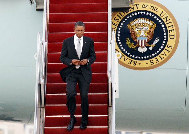 President Barack Obama walks down the stairs from Air Force One upon his arrival at Andrews Air Force Base, Md., on Friday, Sept. 24, 2010. (AP Photo/Jose Luis Magana)