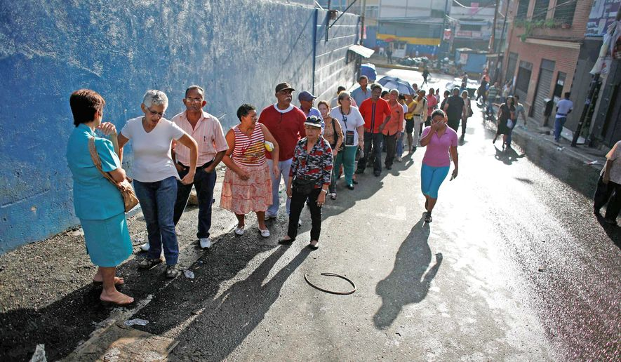 Voter turnout was high at this polling station in Caracas and across Venezuela on Sunday. Five years after boycotting the last round of legislative elections, the opposition is unified and is accusing the government of widespread corruption and an assault on democracy. (Associated Press)