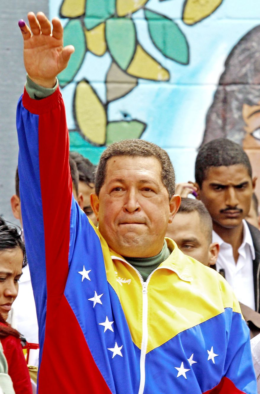 Venezuelan President Hugo Chavez greets supporters after casting his ballot. His approval rating has fallen below 50 percent as the gross domestic product shrinks and the inflation rate rises. (Associated Press)