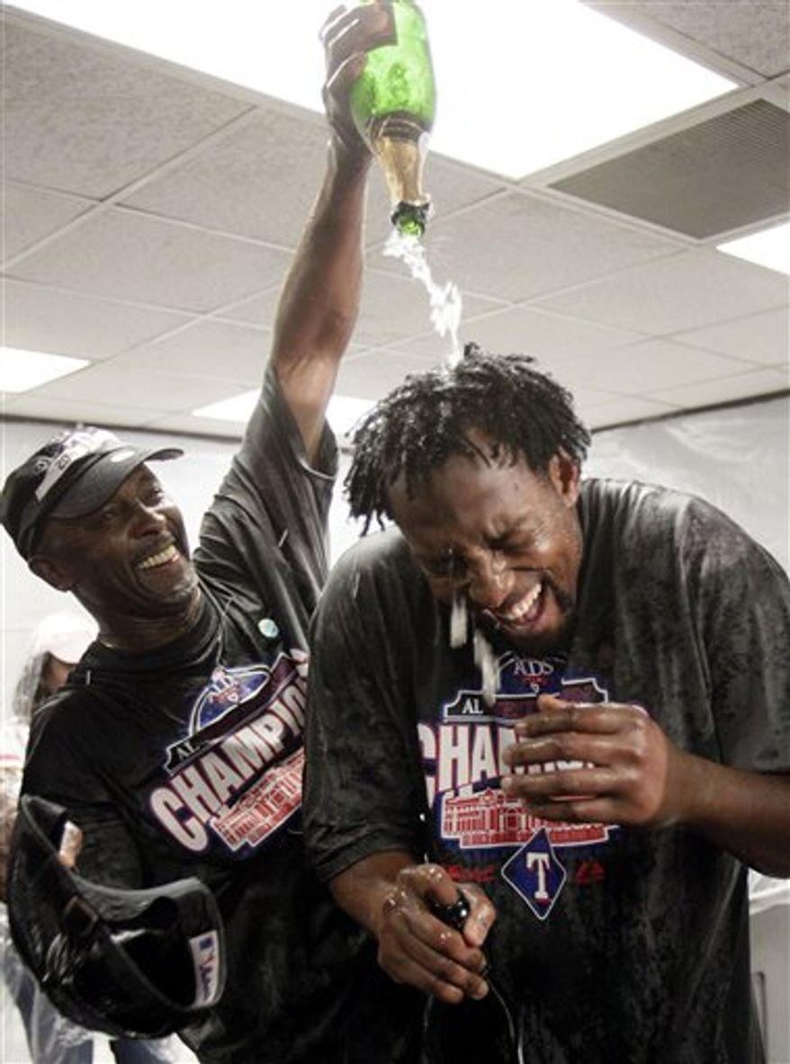 The Texas Rangers celebrate after defeating the Oakland Athletics to clinch the AL West title after a baseball game Saturday, Sept. 25, 2010, in Oakland, Calif. (AP Photo/Ben Margot)