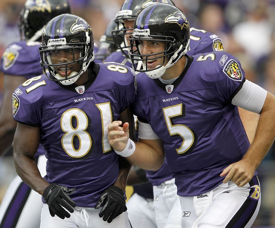 ASSOCIATED PRESS Baltimore Ravens wide receiver Anquan Boldin, left, and quarterback Joe Flacco run off the field after Boldin scored on a Flacco pass during the second half of an NFL football game in Baltimore, on Sunday, Sept. 26, 2010. The Ravens defeated the Cleveland Browns 24-17.