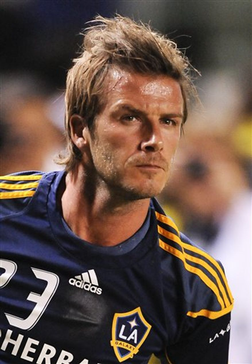 Los Angeles Galaxy midfielder David Beckham, bottom, tackels New York Red Bulls forward Salou Ibrahim (29) as he attempts to steal the ball during the second half of an MLS soccer match, Friday, Sept. 24, 2010, in Carson, Calif. The Red Bulls won 2-0. (AP Photo/Gus Ruelas)