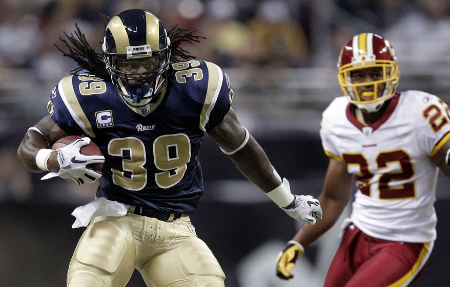 ASSOCIATED PRESS St. Louis Rams running back Steven Jackson, left, runs past Washington Redskins  cornerback Carlos Rogers on his way to a 42-yard touchdown run during the first quarter of an NFL football game Sunday, Sept. 26, 2010, in St. Louis.