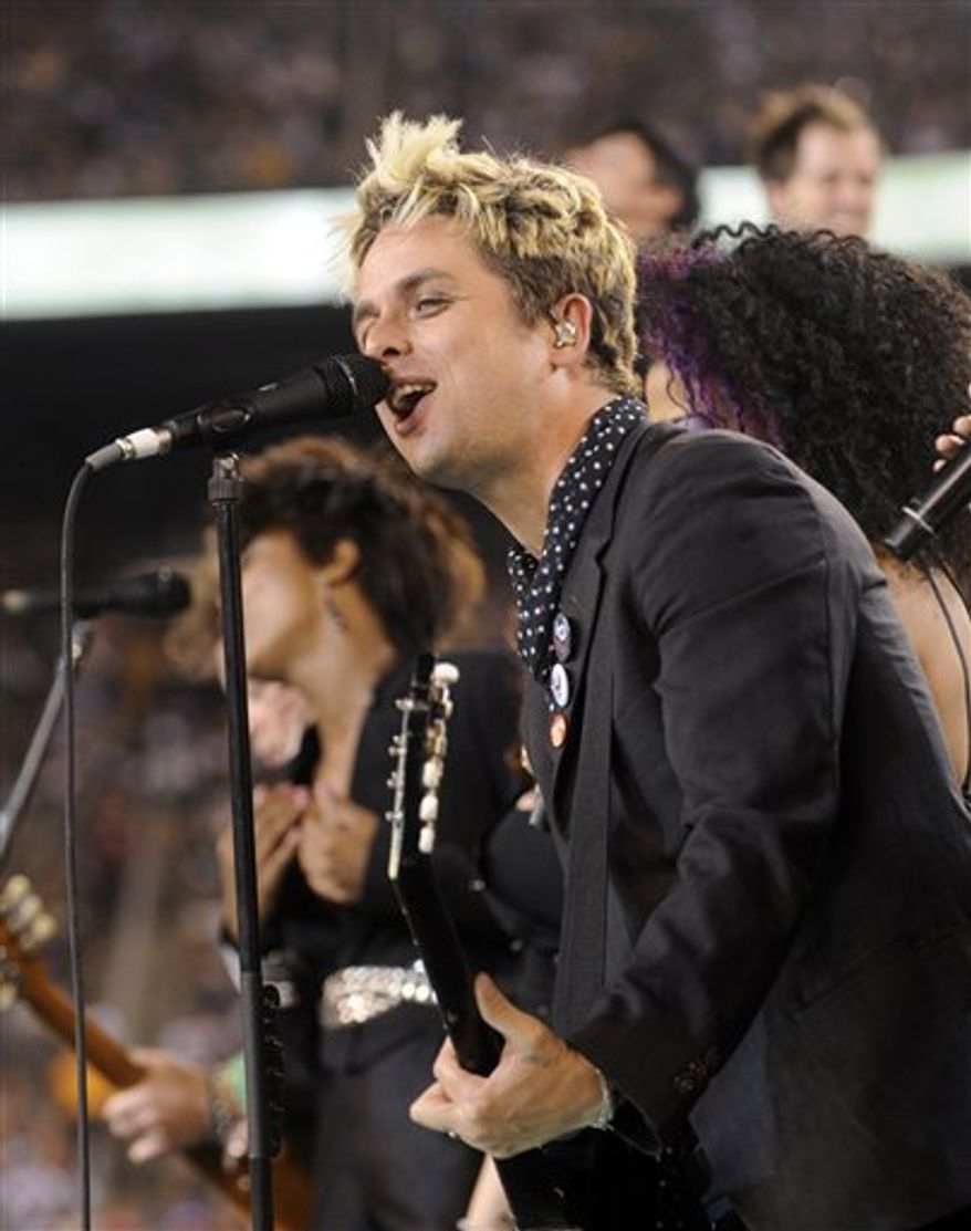 "FILE - In this Sept. 13, 2010 file photo, Billie Joe Armstrong of Green Day performs with cast members of the Broadway musical ""American Idiot"" at halftime during an NFL football game between the New York Jets and the Baltimore Ravens at New Meadowlands Stadium in East Rutherford, N.J. Green Day front man Billie Joe Armstrong is joining the cast of ""American Idiot,"" the Broadway show he helped create based on the band's 2004 Grammy-winning album, The Associated Press reported Sunday, Sept. 26, 2010. (AP Photo/Henny Ray Abrams, File)"