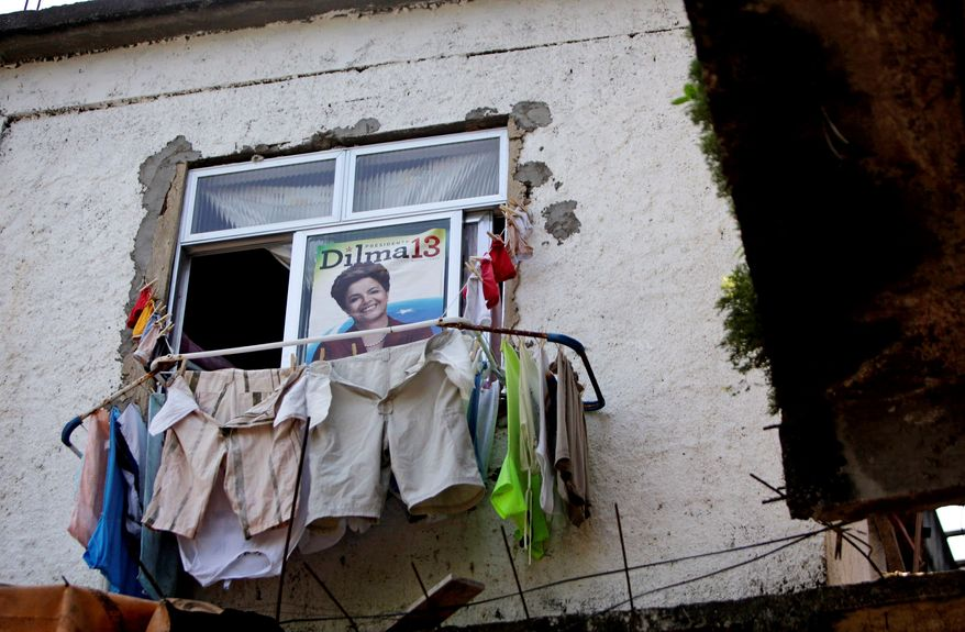 A Rousseff poster hangs above the laundry at a home in Rio de Janeiro's Pavao-Pavaozinho slum. Mrs. Rousseff's quick rise is a testament to the popularity of her mentor, Mr. da Silva. (Associated Press)