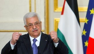 """Palestinian Authority President Mahmoud Abbas says he won't have any """"quick reactions"""" to Israel's resumption of settlement construction in the West Bank. (Associated Press)"""