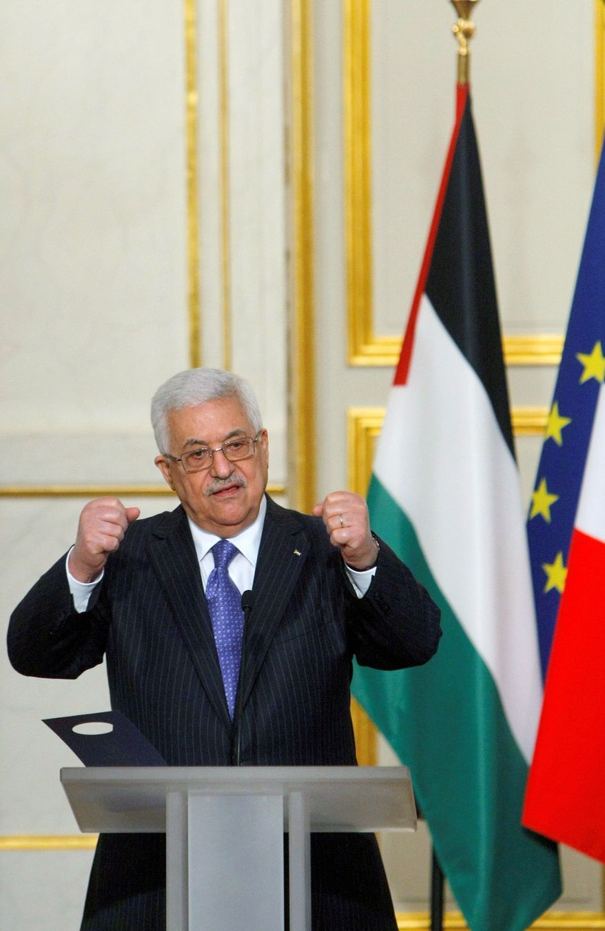 "Palestinian Authority President Mahmoud Abbas says he won't have any ""quick reactions"" to Israel's resumption of settlement construction in the West Bank. (Associated Press)"