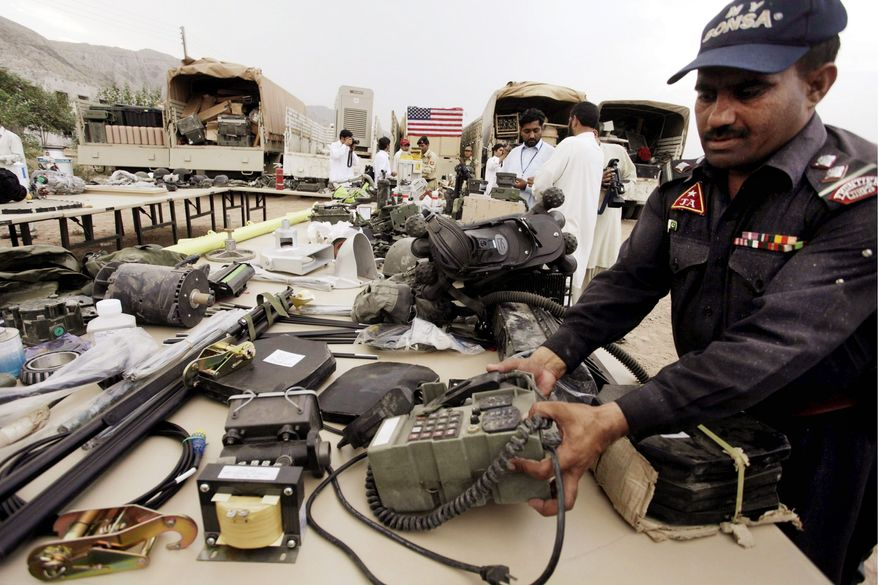 A Pakistani officer in Peshawar displays recovered equipment of NATO forces fighting in neighboring Afghanistan on Monday. The paramilitary Frontier Corps has recovered a variety of military gear stolen from NATO convoys in recent months in Pakistan's Khyber tribal region, official said. (Associated Press)