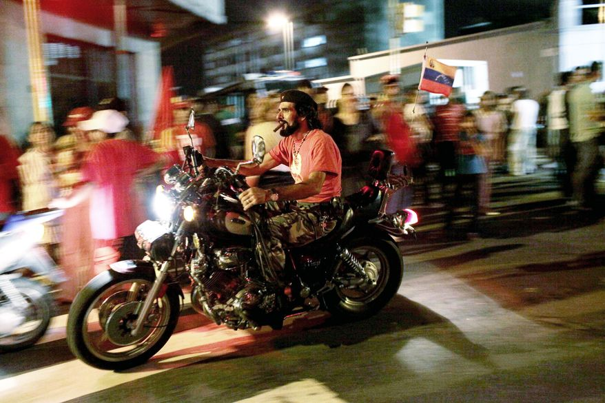 "PASSING FANCY: Posing as Cuban revolutionary ""Che"" Guevara, a rider passes near the Venezuelan presidential palace. Voters gave a newly unified opposition a significant bloc of National Assembly seats. (Associated Press)"