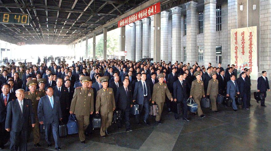 In this photo released by the Korean Central News Agency, delegates to North Korea's ruling Workers' Party meeting arrive Monday in Pyongyang, North Korea. The reclusive Stalinist state holds its biggest political gathering in decades Tuesday. (Associated Press)