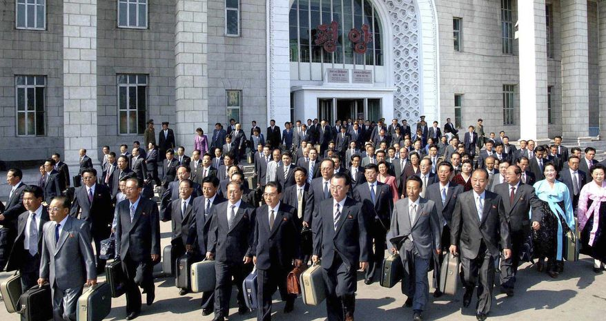 In this photo released by Korean Central News Agency via Korea News Service, delegates to the ruling Worker's Party meeting make their way upon arriving at Pyongyang station in North Korea on Monday. North Korea holds its biggest political meeting in decades Tuesday, amid intense speculation that members of leader Kim Jong Il's family will assume key positions in the ruling party to solidify their rule for another generation. (Associated Press/Korean Central News Agency via Korea News Service)