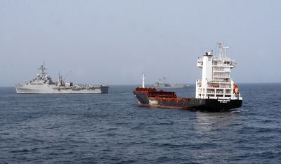 In this Sept. 9, 2010, photo released by the U.S. Navy, the amphibious transport dock ship USS Dubuque, left, is on station with the Turkish frigate TCG Gokceada, during a board and seizure operation by the U.S. Marine Corps 15th Marine Expeditionary Unit, Maritime Raid Force, after the motor vessel Magellan Star was attacked and boarded by pirates on Sept. 8, 2010, off the coast of Somalia. (AP Photo/U.S. Navy, Cryptologic Technician 2nd Class William Farmerie)
