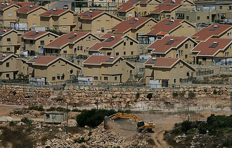 Israeli earth-moving equipment works in the Jewish settlement of Kiryat Netafim, near the West Bank village of Salfit, Monday, Sept. 27, 2010. Senior Palestinian official Yasser Abed Rabbo said Monday that President Mahmoud Abbas remains ready to walk out on Mideast peace talks if Israel resumes construction in its West Bank settlements now that building restrictions have expired. (AP Photo/Nasser Ishtayeh)