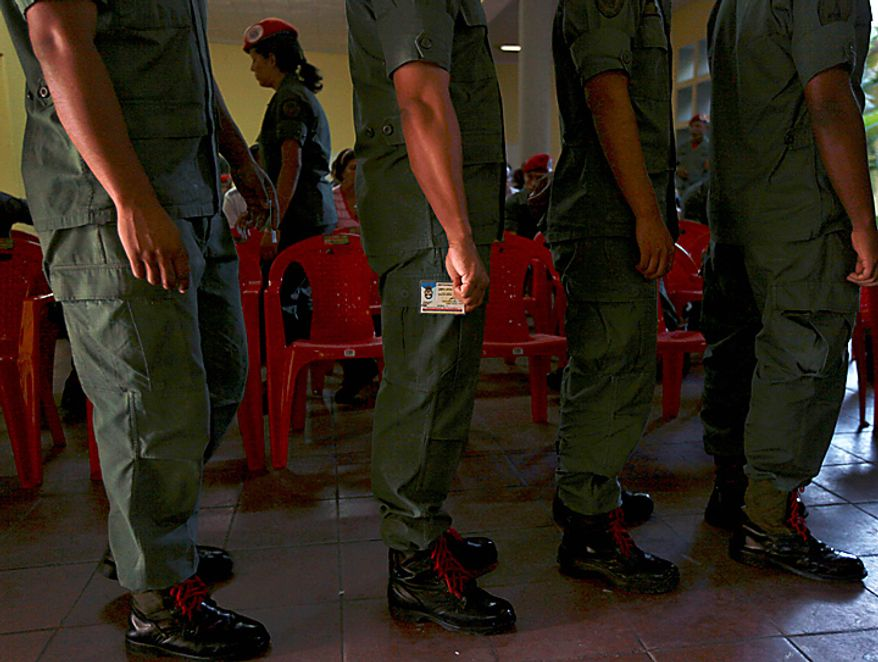 Soldiers wait in line before casting their ballots at a polling station during congressional elections in Caracas, Venezuela, Sunday, Sept. 26, 2010. (AP Photo/Fernando Llano)