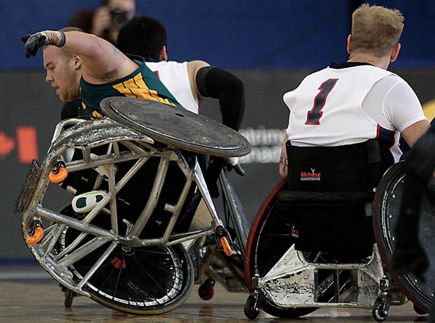 Australia's Ryley Batt, left, falls after colliding with United States' Chance Sumner during the gold medal match at the World Wheelchair Rugby Championships in Richmond, British Columbia, on Sunday, Sept. 26, 2010. (AP Photo/The Canadian Press, Darryl Dyck)