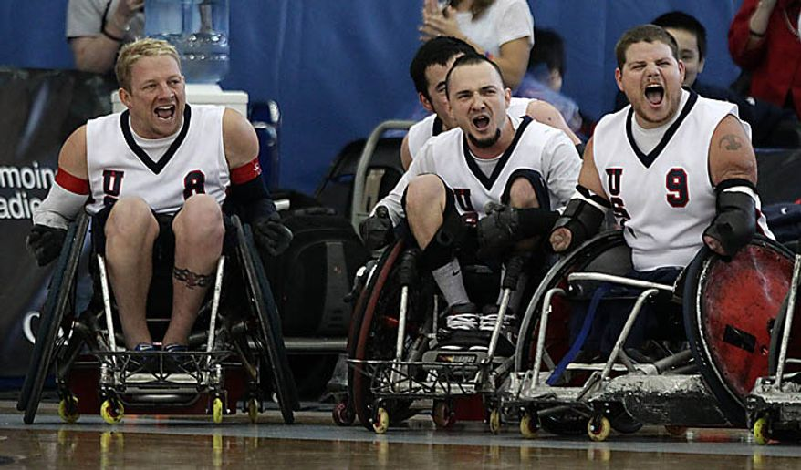 USA's Scott Hogsett, left to right, Chad Cohn and Nick Springer celebrate after defeating Australia in the gold medal match at the World Wheelchair Rugby Championships in Richmond, British Columbia, Canada on Sunday Sept. 26, 2010. (AP Photo/The Canadian Press, Darryl Dyck)