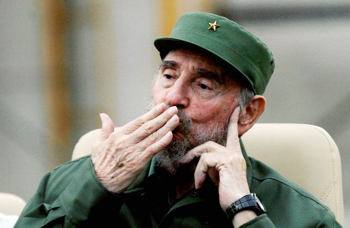 Students among a crowd of 20,000 celebrate as former Cuban President Fidel Castro delivers a speech in Havana during the 50th anniversary of the Committee for the Defense of the Revolution, the nation's neighborhood vigilance system. (Associated Press)