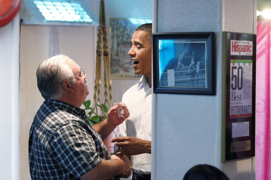 Associated Press President Obama chats with a patron during an unscheduled stop at Barelas Coffee House on Tuesday in Albuquerque, N.M. He warned New Mexico voters that Republicans would roll back his agenda.