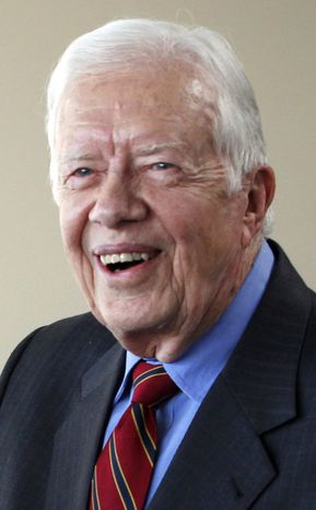 In an Aug. 31, 2010, file photo, former President Jimmy Carter leaves the State Department in Washington. An airport spokeswoman in Cleveland says former President Jimmy Carter ha