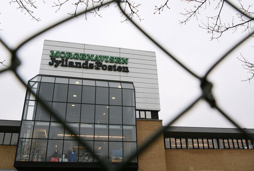 ** FILE ** The headquarters of the Jyllands-Posten newspaper in Aarhus, Denmark, is protected by a metal fence and round-the-clock security guards, and all mail is scanned before being opened. The newspaper has been the target of terrorists for publishing cartoons that caricatured the Prophet Muhammad. (AP Photo/ Polfoto/Kaare Viemose, File)