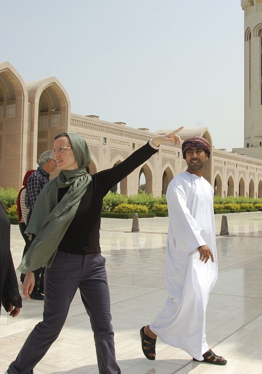 In this photo released by the U.S. Embassy in Oman, Sarah Shourd, center-left, gestures as she visits the Sultan Qaboos Grand Mosque in Muscat, Oman, Saturday, Sept. 18, 2010. Miss Shourd was released from Iran after more than 13 months in custody. (AP Photo/U.S. Embassy in Oman)