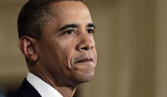 ** FILE ** President Obama (AP Photo/J. Scott Applewhite)
