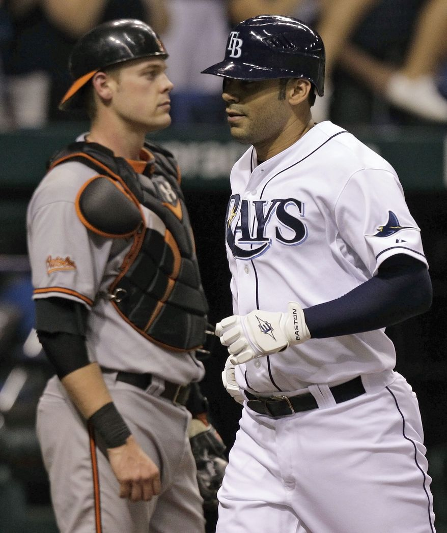 ASSOCIATED PRESS Tampa Bay Rays' Carlos Pena, right, runs past Baltimore Orioles catcher Matt Wieters after hitting a fourth-inning home run off Orioles' Brad Bergesen during a baseball game Tuesday, Sept. 28, 2010, in St. Petersburg, Fla.