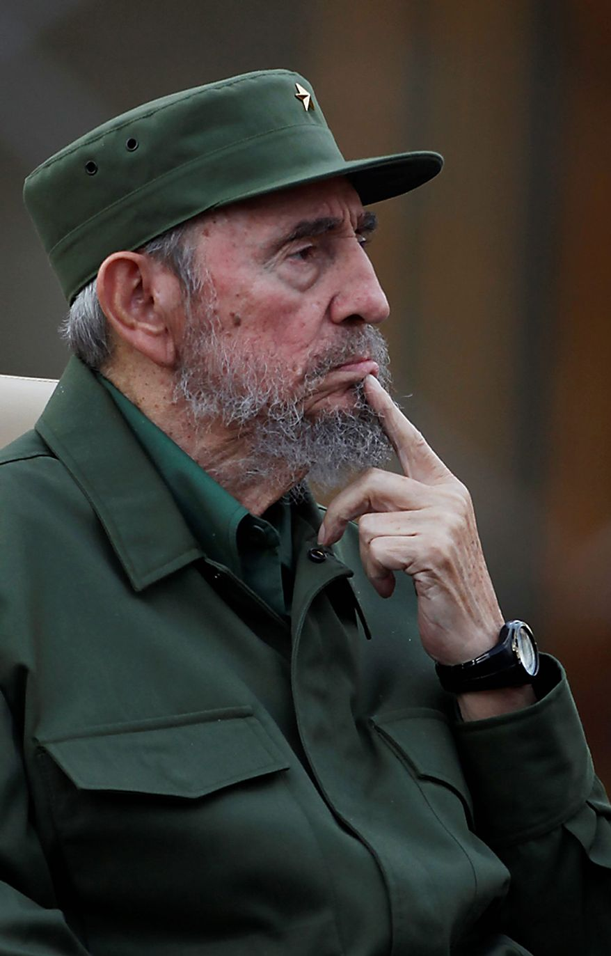 Cuba's leader Fidel Castro listens before delivering a speech during the 50th anniversary of the Committee for the Defense of the Revolution, CDR, in Havana, Cuba, Tuesday, Sept. 28, 2010. (AP Photo/Javier Galeano)