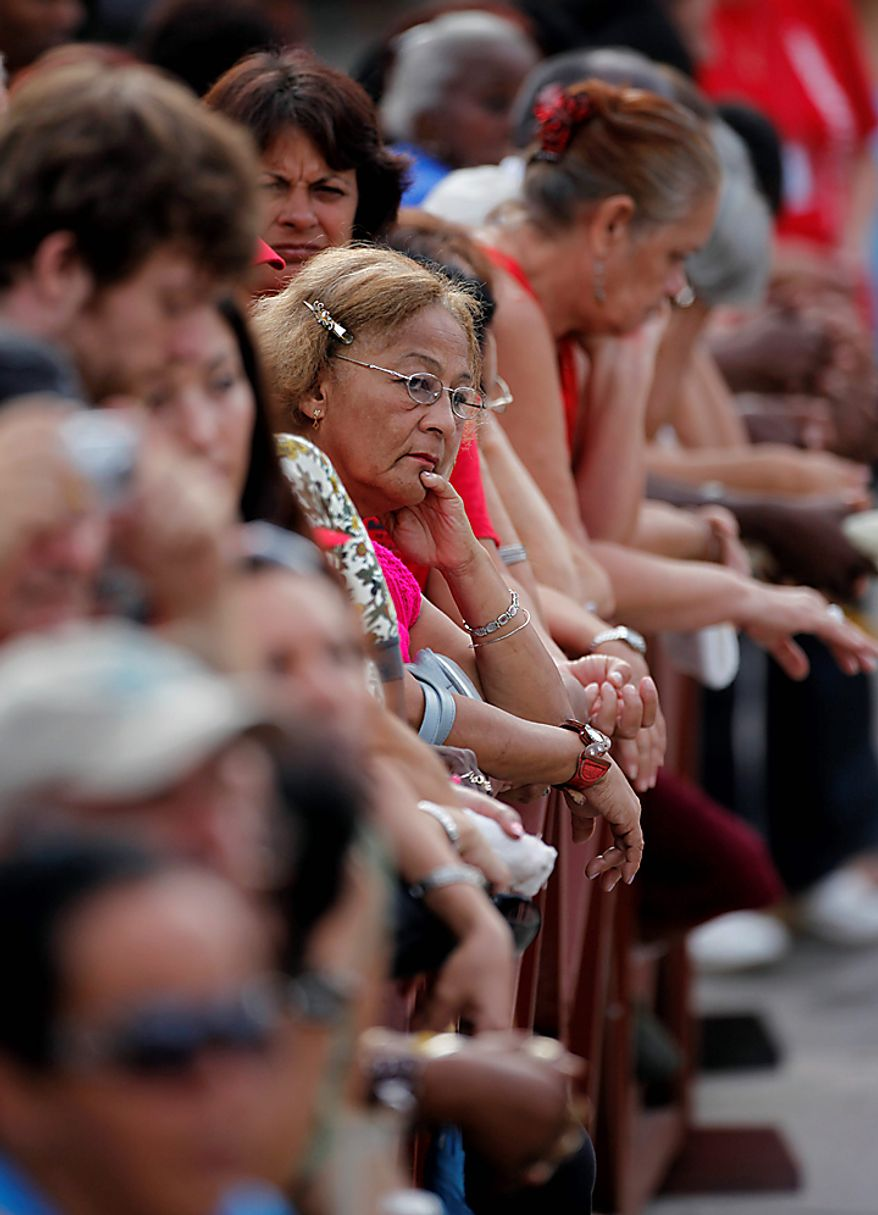 People listen to Cuba's leader Fidel Castro, unseen, as he delivers a speech during the 50th anniversary of the Committee for the Defense of the Revolution, CDR, in Havana, Cuba, Tuesday, Sept. 28, 2010. (AP Photo/Javier Galeano)