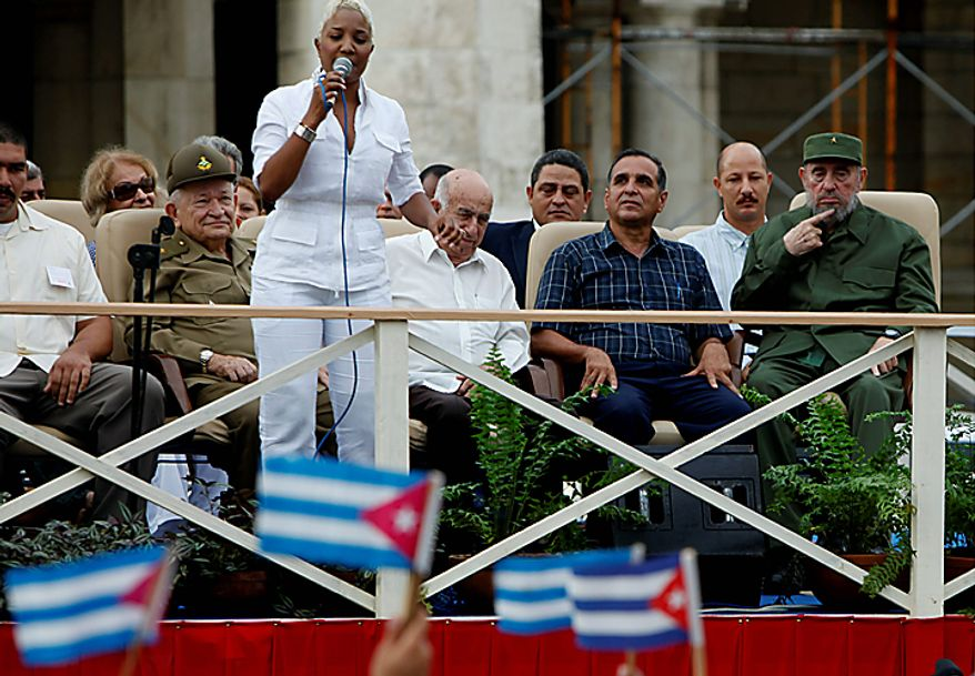 Cuba's leader Fidel Castro, right, listens to Cuba's singer Haila before delivering a speech during the 50th anniversary of the Committee for the Defense of the Revolution, CDR, in Havana, Cuba, Tuesday, Sept. 28, 2010. From left: Revolutionary Commander Guillermo Garcia Frias, Cuba's Vice-President Jose Ramon Machado Ventura and CDRs Coordinator Juan Jose Rabilero. (AP Photo/Javier Galeano)