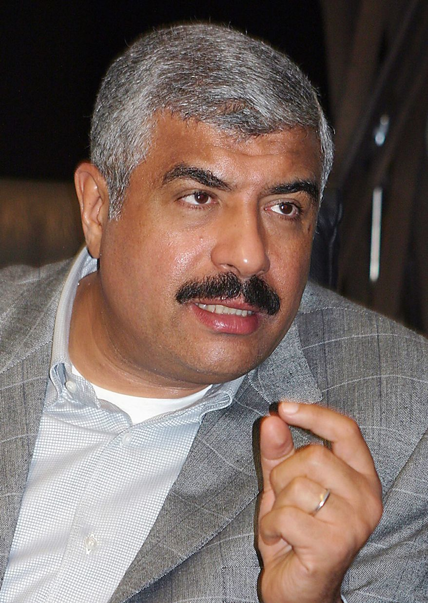 In this Sunday, Aug. 3, 2008 file photo, prominent Egyptian real estate mogul and lawmaker Hisham Talaat Moustafa talks in Cairo. In a case which has captivated the Arab public, an Egyptian court has handed billionaire tycoon Hisham Talaat Moustafa a lighter sentence of just 15 years after an earlier trial sentenced him to death for paying a retired Egyptian police officer to kill his popstar lover, Lebanese singer Suzanne Tamim. (AP Photo, File)